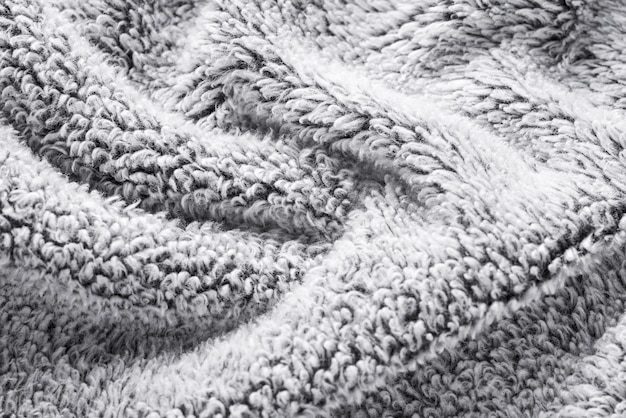 Textiler hintergrund des grauen pelztextils