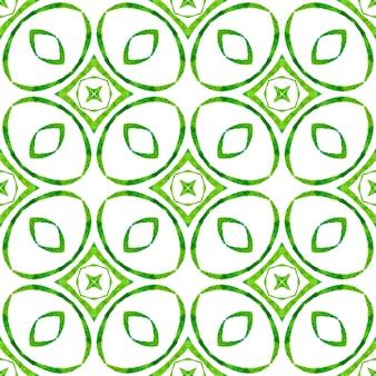 Textilfertiger wundersamer druck, bademodenstoff, tapete, verpackung. grünes ausgezeichnetes boho-chic-sommerdesign. handgezeichnete tropische nahtlose grenze. tropisches nahtloses muster.