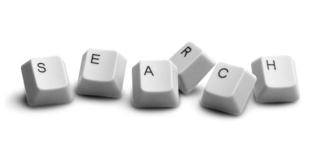 Textsuche mit computertastaturtasten auf weißem hintergrund gebildet
