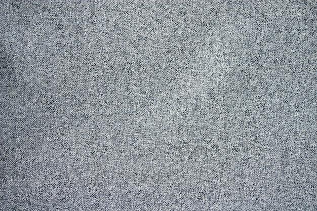 Textur aus grauem wollstoff.