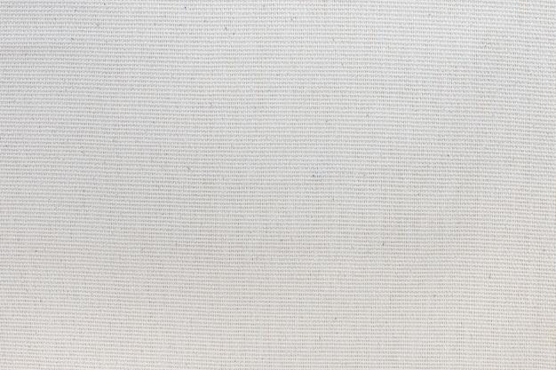 Textur aus natürlichem baumwollstoff mit elfenbeinfarbener nahaufnahme.