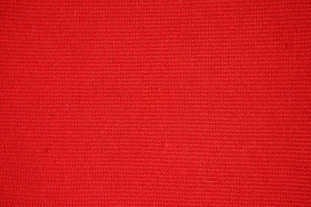 Textur aus rotem wollstoff.
