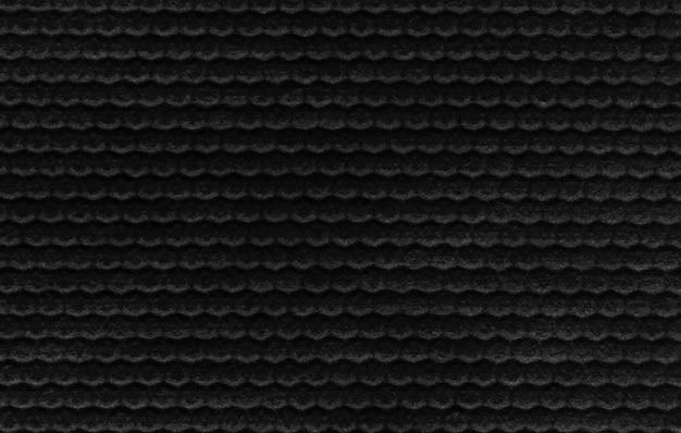 Textur aus schwarzem stoff mit pickeln