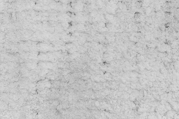 Textur aus weißem gips. raue wand des gebäudes.