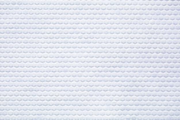 Textur aus weißem stoff mit pickeln