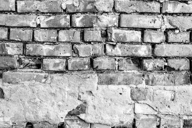 Textur, backstein, wand hintergrund. ziegelsteinbeschaffenheit mit kratzern und sprüngen