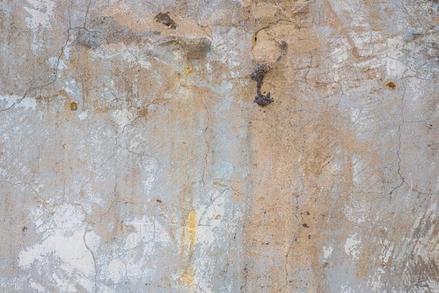 Textur der alten mauer eines alten grauen hauses