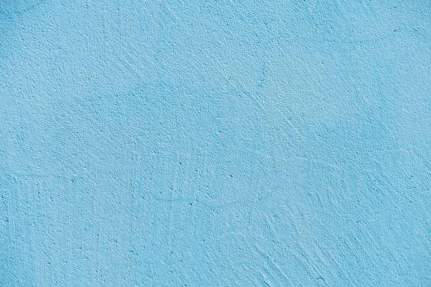 Textur der blauen stein- oder zementwand im sonnenlicht für muster, wand oder 3d. horizontal, nahaufnahme