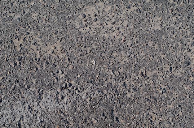 Textur der fahrbahn aus asphalt beton mit einem netz von rissen