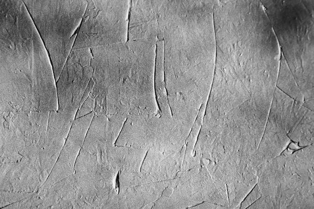 Textur der grauen betonwand der kittoberfläche mit schwarzen farbflecken