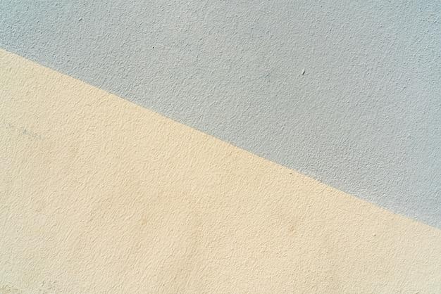 Textur der grauen und gelben stuckbeschaffenheitstapete