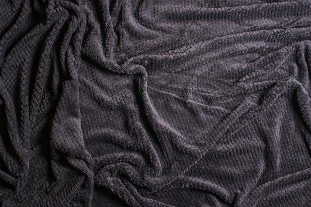 Textur der grauen wolldecke