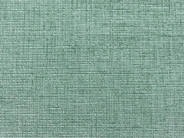 Textur der grünen tapete mit einem muster