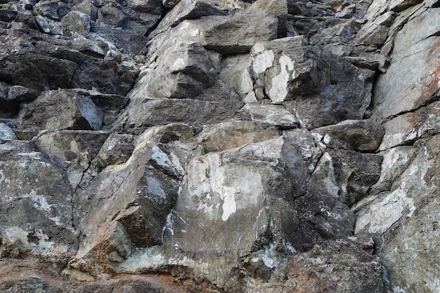 Textur der natursteinfelsen-hintergrundtapete weiß grau und schwarz spritzt auf der oberfläche horizontale rechteckige fotografie