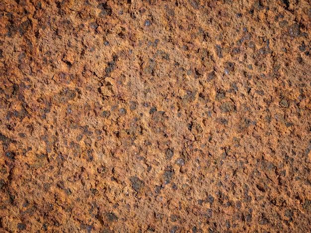 Textur der oberfläche der rostigen metallwand.