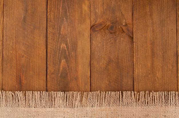Textur der sackleinen und des alten holzes
