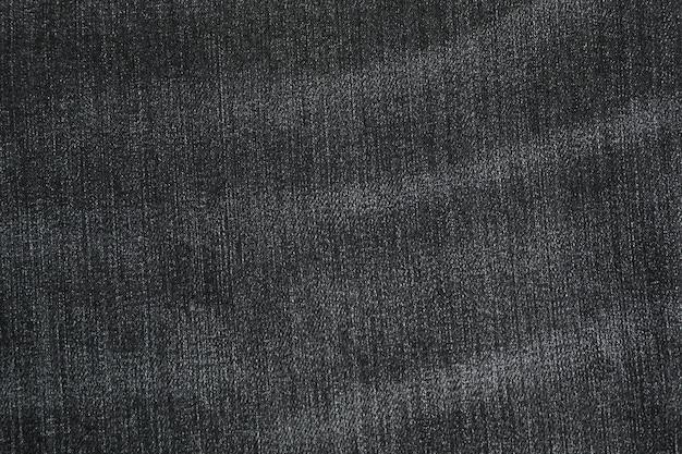 Textur der schwarzen jeans als hintergrund, raum für text