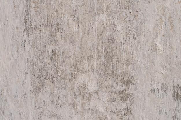 Textur der weiß getünchten alten schäbigen wand