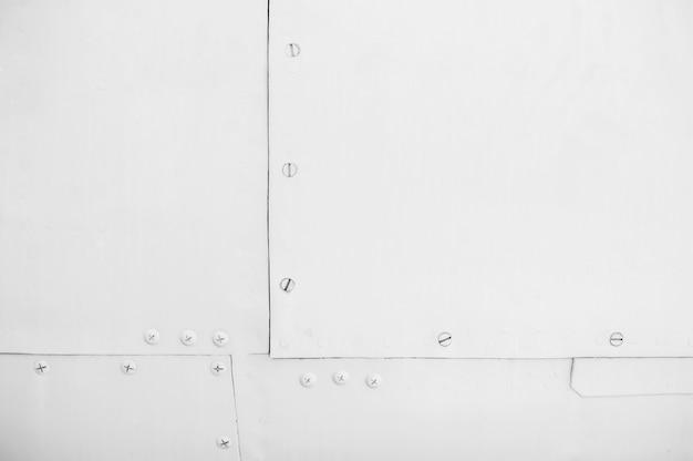 Textur der weißen metallplatten mit nieten