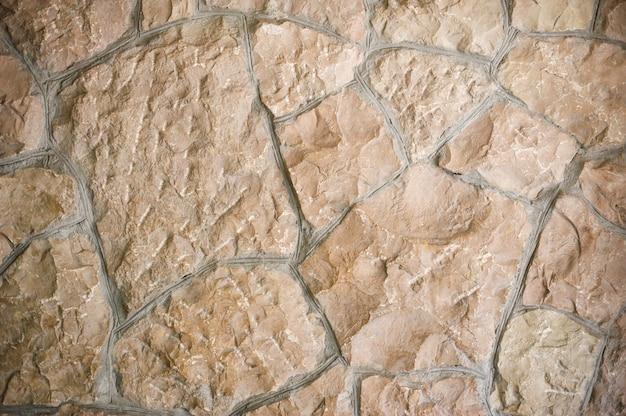 Textur der wilden steinmauer mit platz für text
