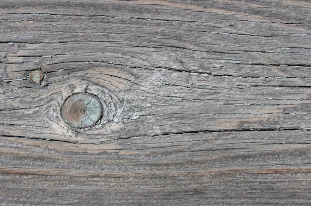 Textur des alten verwitterten knotenbretts