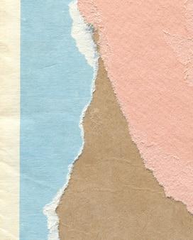 Textur des alten vintage zerrissenes mehrfarbiges papier