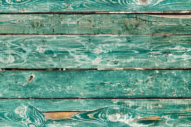 Textur des alten zauns von den grünen ländlichen brettern