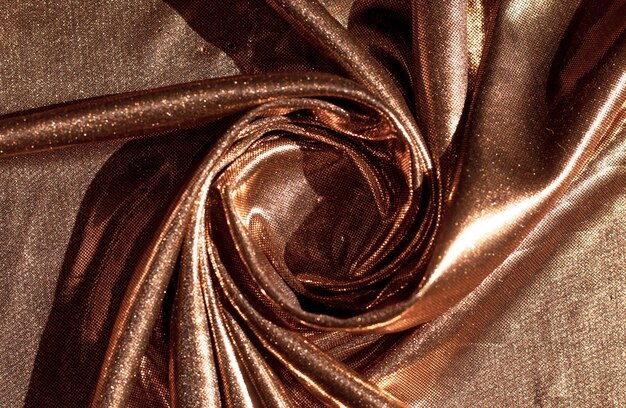 Textur des goldenen gewebes in den wellen, hintergrund