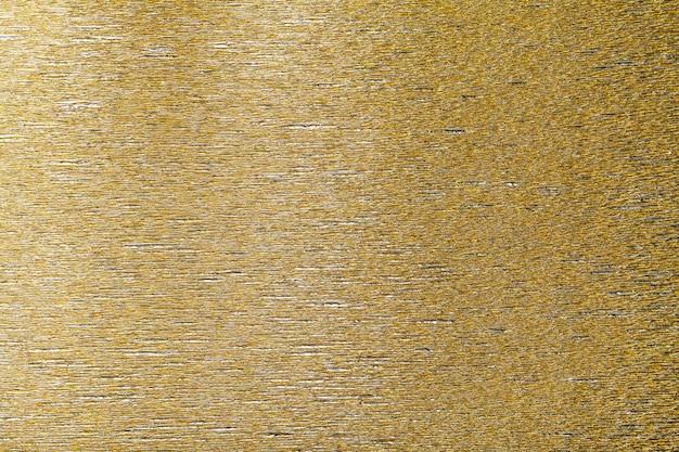 Textur des goldenen hintergrundes des gewellten wellpappens