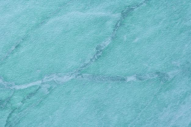 Textur des hellblauen marmors mit muster, makrohintergrund. türkis abstrakter steinhintergrund, nahaufnahme.