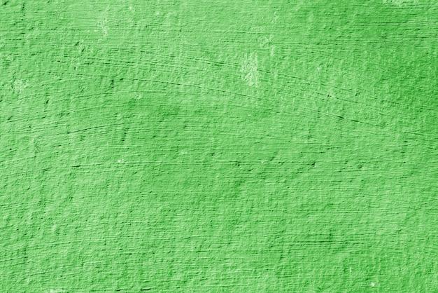 Textur des rauen grünen putzes. architektonischer abstrakter hintergrund.