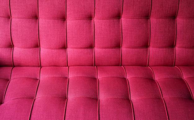 Textur des roten stoffsofas.