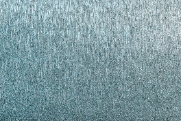 Textur des türkisfarbenen hintergrunds des gewellten wellpappenpapiers, nahaufnahme.