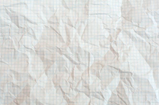 Textur des zerknitterten weißen papiers in einem käfig