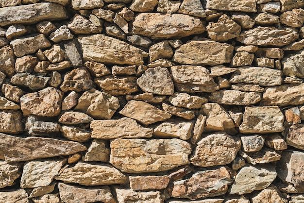 Textur einer alten mauer aus natursteinen