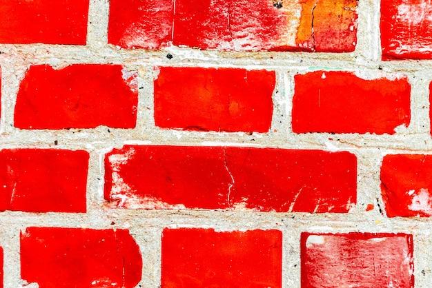Textur einer backsteinmauer mit rissen und kratzern, die als hintergrund verwendet werden können