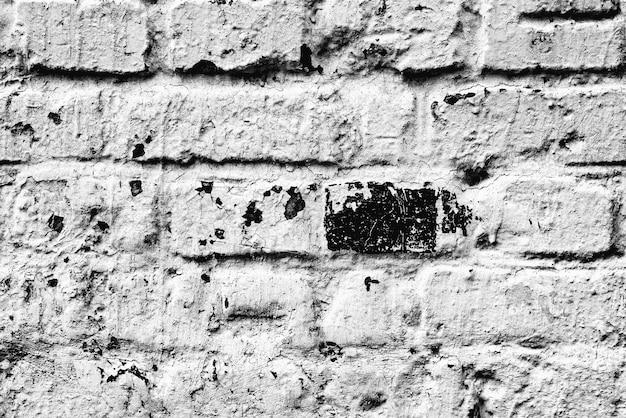 Textur einer mauer mit rissen und kratzerhintergrund