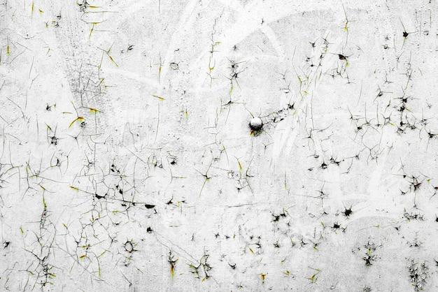 Textur einer metallwand mit rissen und kratzern, die als hintergrund verwendet werden können