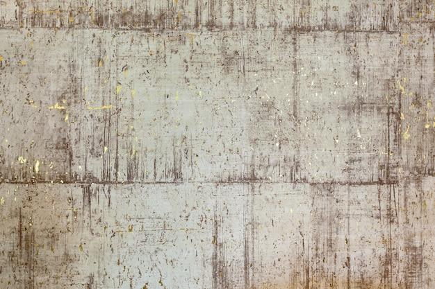Textur einer steinmauer mit gold. der abstrakte hintergrund der schönheit aus der strukturierten geprägten oberfläche der weißen, grauen, schwarzen und goldenen farben. das komplexe mischbild für die dekoration eines modernen sma