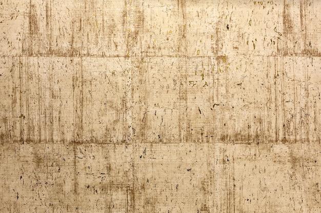 Textur einer steinmauer mit gold der abstrakte hintergrund der schönheit aus der strukturierten geprägten oberfläche