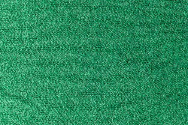 Textur eines grünen wollpullovers