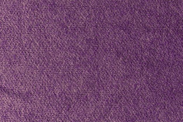Textur eines lila wollpullovers
