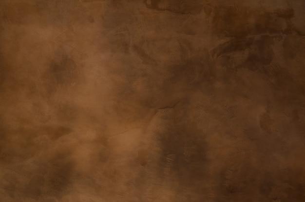 Textur eines orangebraunen betons als hintergrund, braune grungy wand - tolle texturen für den hintergrund