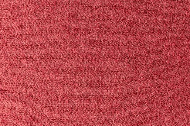 Textur eines roten wollpullovers