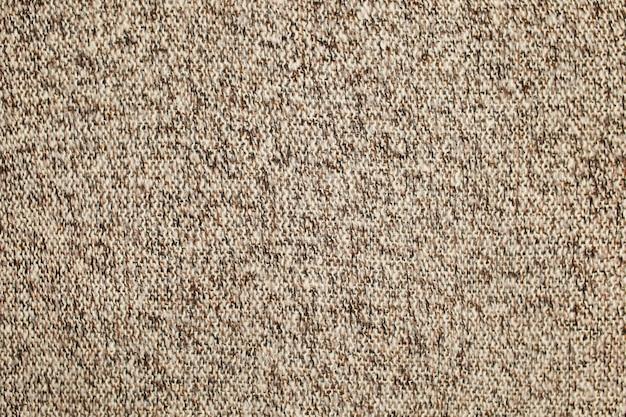 Textur gestrickte wolloberfläche braun beige weiß. hintergrund, tapete aus fasern. warmer stoff. hochwertiges foto