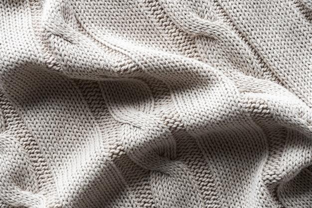 Textur grauer strickstoff mit einem muster