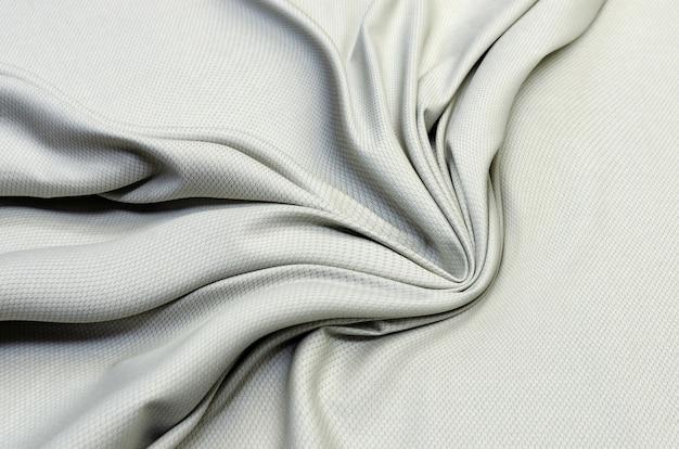 Textur, grauer strukturierter baumwollstoff zum zuschneiden.