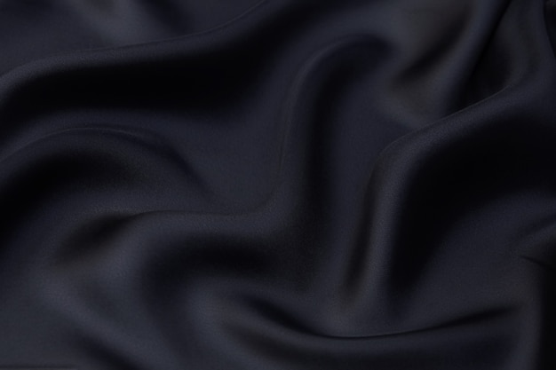 Textur, hintergrund, muster. schwarzer rayonstoff zum zuschneiden.