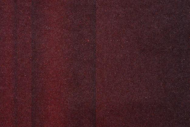 Textur in dunklen rottönen