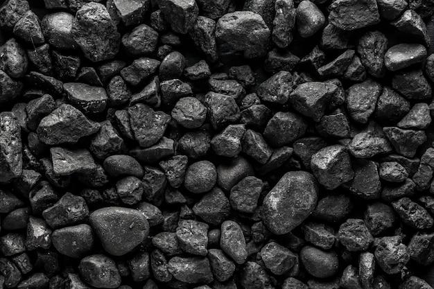 Textur mattschwarzer stein dunkler hintergrund kleine steine